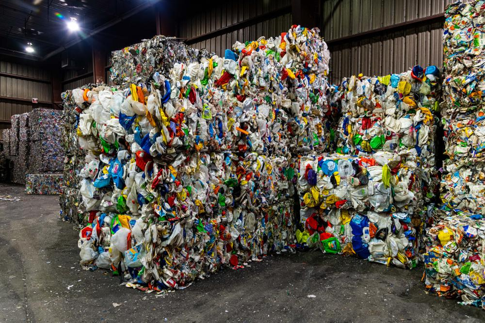 Plastic recycling material, sorted and baled at the processing plant, ready for shipping.