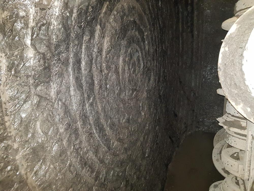 Picture showing circular markings similar to a bullseye on large rock face.