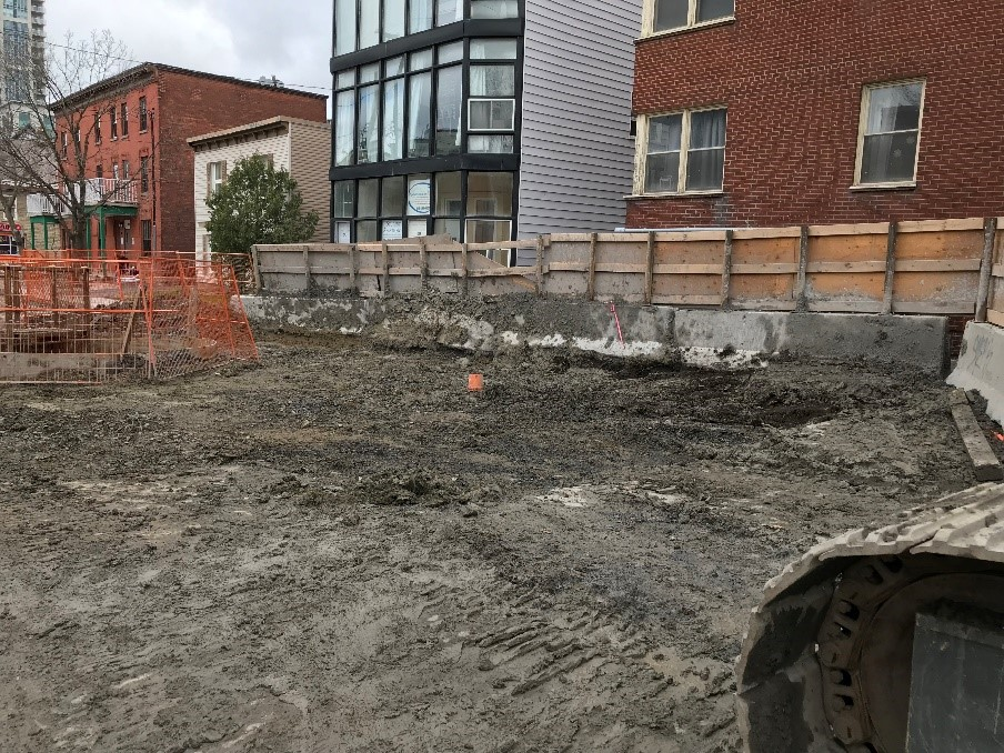 Picture showing a construction site with houses in the background.