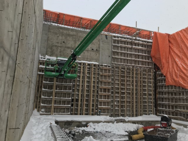 Picture of construction of a building showing large concrete walls.