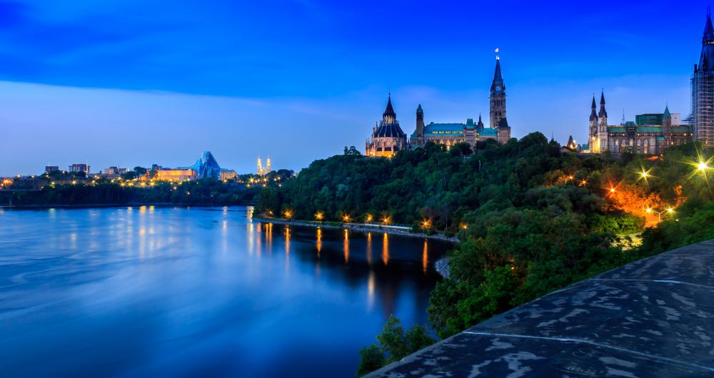 Picture of the Ottawa River, showing Parliament in the background.