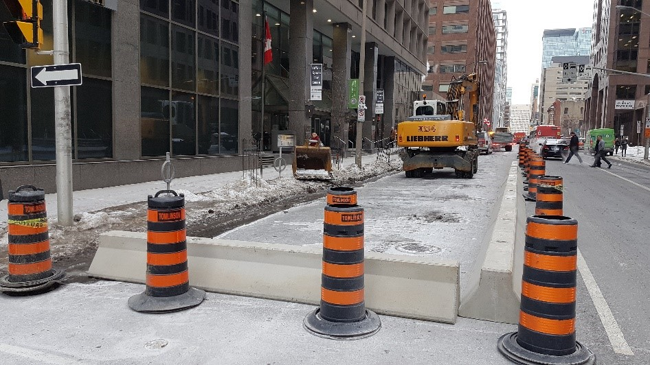 A construction site in the middle of a city street.